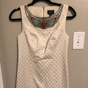 Elegant dress with ornate neck design by Laundry